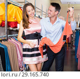 Купить «Couple is considering an assortment of dresses», фото № 29165740, снято 11 апреля 2017 г. (c) Яков Филимонов / Фотобанк Лори