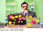Купить «Businessman unhappy with many conflicting priorities sitting in», фото № 29167624, снято 18 мая 2018 г. (c) Elnur / Фотобанк Лори