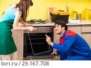 Купить «Woman with contractor at kitchen discussing repair», фото № 29167708, снято 20 июня 2018 г. (c) Elnur / Фотобанк Лори