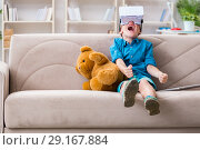 Купить «Young little boy with VR virtual reality glasses», фото № 29167884, снято 24 июня 2017 г. (c) Elnur / Фотобанк Лори