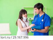 Купить «Female patient visiting male doctor in medical concept», фото № 29167996, снято 28 мая 2018 г. (c) Elnur / Фотобанк Лори