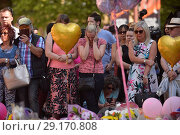 Купить «Scenes at St. Anne's square just before the minute silence for the victims of the terror attack on Sunday night Featuring: Atmosphere Where: Manchester...», фото № 29170808, снято 25 мая 2017 г. (c) age Fotostock / Фотобанк Лори