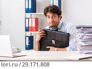 Купить «Overloaded busy employee with too much work and paperwork», фото № 29171808, снято 3 июля 2018 г. (c) Elnur / Фотобанк Лори