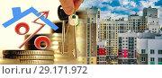 Купить «Символ процента на фоне строительства нового жилого района», фото № 29171972, снято 25 мая 2019 г. (c) Сергеев Валерий / Фотобанк Лори