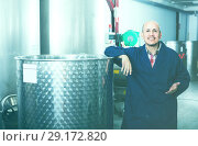 Купить «thoughtful mature man working in wine secondary fermentation sec», фото № 29172820, снято 15 октября 2018 г. (c) Яков Филимонов / Фотобанк Лори