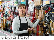 Купить «Professional young cheerful friendly salesman working and smiling», фото № 29172960, снято 19 ноября 2018 г. (c) Яков Филимонов / Фотобанк Лори