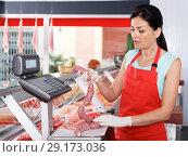 Купить «Female seller weighing sausages in shop», фото № 29173036, снято 22 июня 2018 г. (c) Яков Филимонов / Фотобанк Лори
