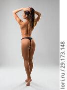 Купить «Fitness model wearing black tanga rearview», фото № 29173148, снято 19 сентября 2018 г. (c) Гурьянов Андрей / Фотобанк Лори