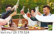 Купить «happy friends toasting drinks at rooftop party», видеоролик № 29179524, снято 26 сентября 2018 г. (c) Syda Productions / Фотобанк Лори