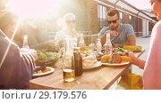 Купить «friends having dinner or bbq party on rooftop», видеоролик № 29179576, снято 26 сентября 2018 г. (c) Syda Productions / Фотобанк Лори