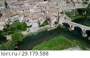 Купить «Aerial view of historic centre of Besalu with Romanesque bridge over Fluvia river, Catalonia, Spain», видеоролик № 29179588, снято 11 июня 2018 г. (c) Яков Филимонов / Фотобанк Лори