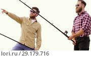 Купить «happy friends with fishing rods», видеоролик № 29179716, снято 28 сентября 2018 г. (c) Syda Productions / Фотобанк Лори