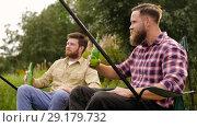 Купить «happy friends fishing and drinking beer», видеоролик № 29179732, снято 28 сентября 2018 г. (c) Syda Productions / Фотобанк Лори