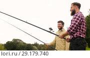 Купить «happy friends with fishing rods», видеоролик № 29179740, снято 28 сентября 2018 г. (c) Syda Productions / Фотобанк Лори