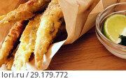 Купить «battered sprats with classic creamy and cheese sauce and greens», видеоролик № 29179772, снято 19 сентября 2018 г. (c) Яков Филимонов / Фотобанк Лори