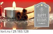 Happy Holidays text with gift, lit candles and cinnamon sticks 4k. Стоковое видео, агентство Wavebreak Media / Фотобанк Лори