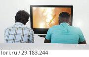 Купить «Two men watching falling autumn leaves on television 4k», видеоролик № 29183244, снято 25 марта 2019 г. (c) Wavebreak Media / Фотобанк Лори