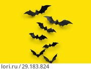 Купить «black halloween bats on yellow background», фото № 29183824, снято 6 июля 2017 г. (c) Syda Productions / Фотобанк Лори