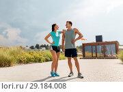 Купить «happy couple in sports clothes outdoors», фото № 29184008, снято 1 августа 2018 г. (c) Syda Productions / Фотобанк Лори