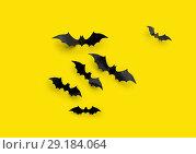 Купить «black halloween bats on yellow background», фото № 29184064, снято 6 июля 2017 г. (c) Syda Productions / Фотобанк Лори