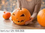 Купить «close up of woman with halloween pumpkin at home», фото № 29184068, снято 15 сентября 2017 г. (c) Syda Productions / Фотобанк Лори