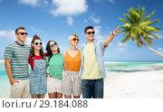 Купить «friends in sunglasses over tropical beach», фото № 29184088, снято 30 июня 2018 г. (c) Syda Productions / Фотобанк Лори
