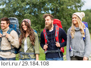 friends or travelers with backpacks hiking. Стоковое фото, фотограф Syda Productions / Фотобанк Лори