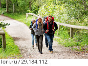Купить «happy friends or travelers hiking with backpacks», фото № 29184112, снято 31 августа 2014 г. (c) Syda Productions / Фотобанк Лори