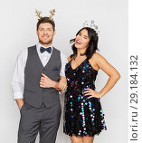 Купить «couple with christmas or new year party props», фото № 29184132, снято 15 декабря 2017 г. (c) Syda Productions / Фотобанк Лори