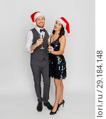 Купить «couple with champagne glasses at christmas party», фото № 29184148, снято 15 декабря 2017 г. (c) Syda Productions / Фотобанк Лори