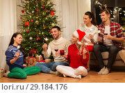 Купить «friends with sparklers celebrating christmas», фото № 29184176, снято 17 декабря 2017 г. (c) Syda Productions / Фотобанк Лори