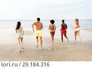 happy friends running on summer beach. Стоковое фото, фотограф Syda Productions / Фотобанк Лори