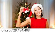 Купить «woman in santa hat with jingle bells on christmas», фото № 29184408, снято 15 августа 2013 г. (c) Syda Productions / Фотобанк Лори