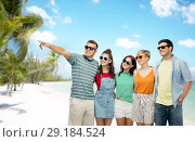 Купить «friends in sunglasses over exotic beach background», фото № 29184524, снято 30 июня 2018 г. (c) Syda Productions / Фотобанк Лори