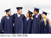 Купить «happy students or bachelors in mortar boards», фото № 29184536, снято 24 сентября 2016 г. (c) Syda Productions / Фотобанк Лори