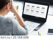 Купить «stressed designer with user interface on laptop», фото № 29184608, снято 17 января 2018 г. (c) Syda Productions / Фотобанк Лори