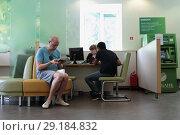 Купить «Люди в отделении Сбербанка», эксклюзивное фото № 29184832, снято 18 июня 2018 г. (c) Дмитрий Неумоин / Фотобанк Лори
