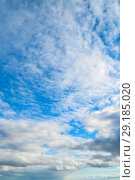 Купить «Sky landscape of blue colorful sky. Blue sky background with clouds and sunset light», фото № 29185020, снято 25 апреля 2018 г. (c) Зезелина Марина / Фотобанк Лори