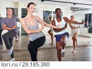 Купить «People dancing lindy hop during group training», фото № 29185380, снято 30 июля 2018 г. (c) Яков Филимонов / Фотобанк Лори