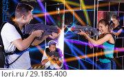 Купить «Two emotional players standing opposite each other with laser pi», фото № 29185400, снято 27 августа 2018 г. (c) Яков Филимонов / Фотобанк Лори