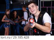 Купить «Excited guy with laser pistol while playing lasertag with his friends», фото № 29185428, снято 27 августа 2018 г. (c) Яков Филимонов / Фотобанк Лори