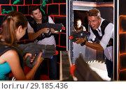 Купить «Excited people playing enthusiastically laser tag game», фото № 29185436, снято 27 августа 2018 г. (c) Яков Филимонов / Фотобанк Лори