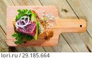 Купить «Delicious sandwich with raw tuna, avocado, greens and onion», фото № 29185664, снято 16 октября 2018 г. (c) Яков Филимонов / Фотобанк Лори