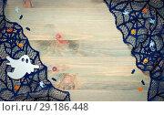 Купить «Halloween background. Spider web, black cobweb lace and spooky ghosts decorations as the symbols of Halloween holiday on the wooden background», фото № 29186448, снято 2 октября 2018 г. (c) Зезелина Марина / Фотобанк Лори