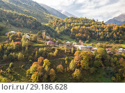 Купить «Picturesque autumn landscape. Zegani village in Upper Svaneti surrounded by mountains. Georgia», фото № 29186628, снято 28 сентября 2018 г. (c) Юлия Бабкина / Фотобанк Лори