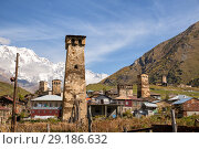 Купить «Ushguli village and typical defensive towers in Upper Svaneti, Georgia», фото № 29186632, снято 28 сентября 2018 г. (c) Юлия Бабкина / Фотобанк Лори