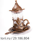 Купить «Turkish tea set. Ottoman teacup with traditional arabic ornaments on white background», фото № 29186804, снято 21 февраля 2016 г. (c) Евгений Ткачёв / Фотобанк Лори