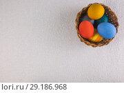 Купить «Colored eggs in the basket, prepared for the Easter holiday», фото № 29186968, снято 16 ноября 2018 г. (c) Владимир Пойлов / Фотобанк Лори