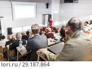 Купить «Business speaker giving a talk at business conference event.», фото № 29187864, снято 10 декабря 2018 г. (c) Matej Kastelic / Фотобанк Лори