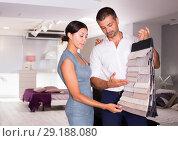 Купить «Couple choosing material for furniture in salon», фото № 29188080, снято 17 июля 2018 г. (c) Яков Филимонов / Фотобанк Лори